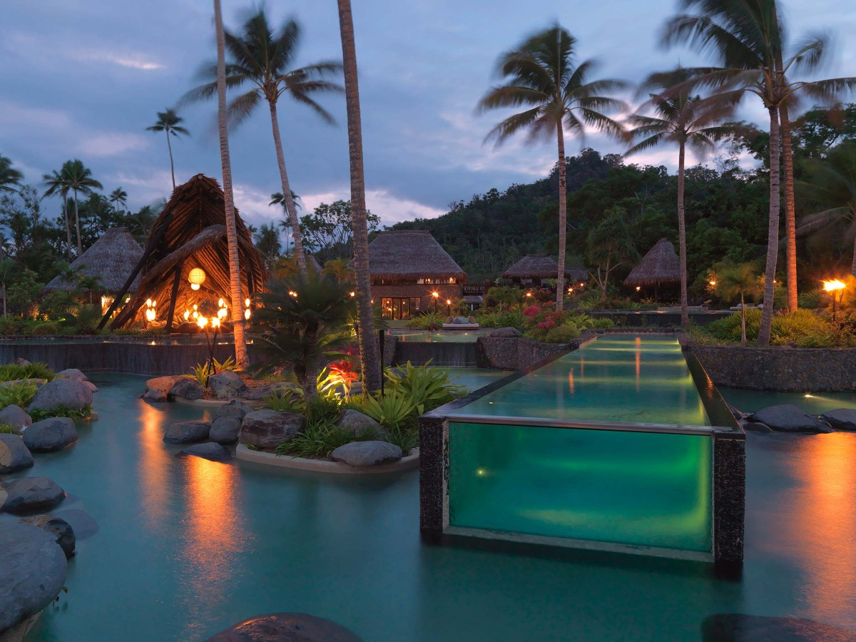 2-laucala-glass-ended-lap-pool-night-lighting